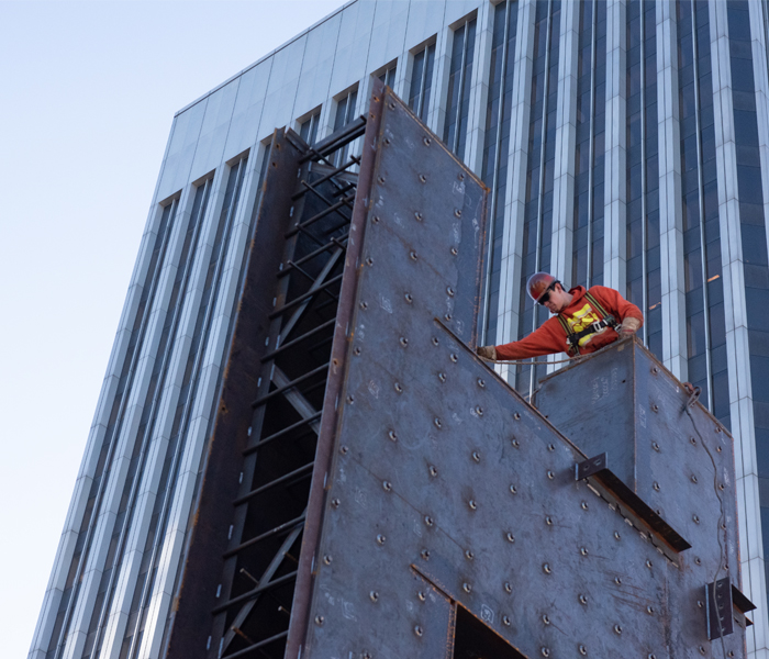 A crew member of the Erection Company works to secure structural steel on the Rainier Square Tower project.